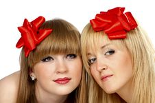Free Two Smiling Young Women With Gift Red Bow Royalty Free Stock Images - 16523229