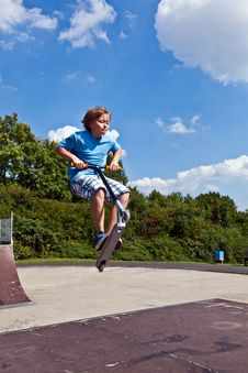 Free Young Boy Going Airborne With His Scooter Royalty Free Stock Photo - 16523305