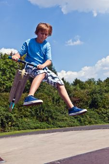 Free Young Boy Going Airborne With His Scooter Royalty Free Stock Photos - 16523308