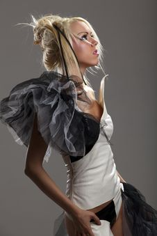 Free Blonde In Black And White Leather Suit Stock Photos - 16524513