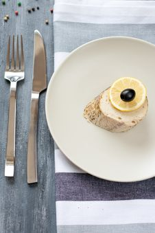 Free Piece Of Stuffed Pike With Lemon On The Plate Royalty Free Stock Image - 16525786