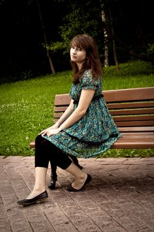 Free Pretty Girl Sitting On A Bench Stock Photography - 16526342