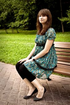 Free Pretty Girl Sitting On A Bench Stock Images - 16526504
