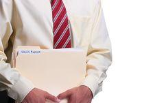 Free Man Holding Folders Royalty Free Stock Photo - 16526805