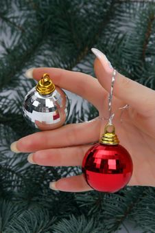 Hand Holding Christmas Balls Stock Image