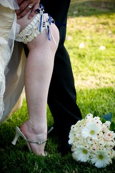 Free Groom's Hand On Bride S Leg With Blue Garter Stock Photos - 16529943