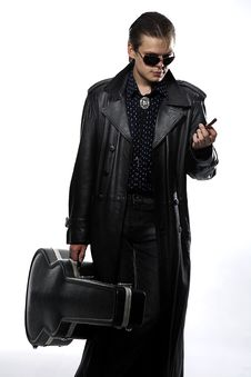 Man With Guitar Case Stock Images