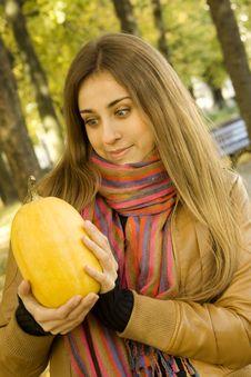 Free Girl Holding A Pumpkin Royalty Free Stock Photos - 16533838