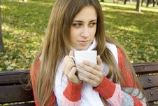 Free Girl Holding Coffee Cup Royalty Free Stock Photography - 16534927