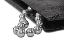 Gray Beads And Black Handbag Stock Image