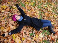 Pretty Autumn Girl Relaxing Outdoors In The Forest Stock Images