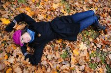 Pretty Autumn Girl Relaxing Outdoors In The Forest Stock Photos