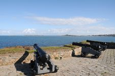 Cannons At Portelet Harbour, Guernsey Stock Photo