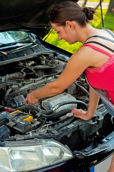 Woman With Her Broken Down Car Stock Photography