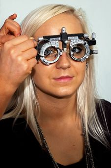 Free Young Woman Examining The Eyesight Stock Photo - 16541790