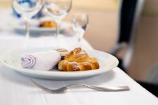 Free Baked Bun On A Plate With A Twisted Napkin Stock Photo - 16541810