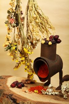 Old Handmill, Spice And Dry Flowers Royalty Free Stock Photography