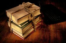 Sheaf Of Old Books And The Laptop Royalty Free Stock Images