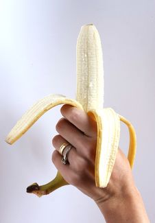 Free Peeled Banana Held In The Hand Stock Photography - 16547182