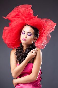 Beautiful Brunette Woman In Red Tulle Hat Royalty Free Stock Photo