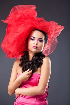 Beautiful Brunette Woman In Red Tulle Hat Stock Photo