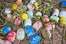 Free Background Made Of Colorful Buoys On Sand Stock Photography - 16548242