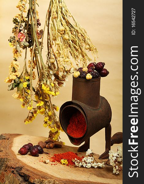 Old handmill, spice and dry flowers