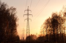 Free Electricity Pylons And Lines At Sunset. Royalty Free Stock Images - 16553289