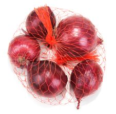 Free Red Onion In Packing From Red Net Stock Photos - 16553483