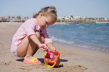 Free Little Girl Plays On Seacoast Stock Photo - 16554630