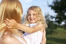 Free Laughing Little Girl In Mother Arms Royalty Free Stock Photo - 16556555