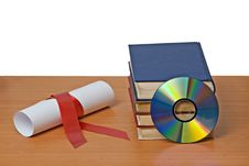 Free Scroll With Red Ribbon And Books Royalty Free Stock Photo - 16556835