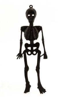 Free Black Plastic Skeleton Over White Stock Image - 16557711
