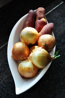 Onions & Sweet Potatoes In Bowl Stock Image