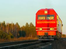 Free Red Passenger Locomotive At Evening Stock Photography - 16559492