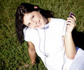 Free Pretty Young Brunette Girl Show Pink Music Player. Stock Image - 16564521