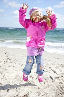 Free Cute Young Girl Having Fun On The Beach Royalty Free Stock Photo - 16562165