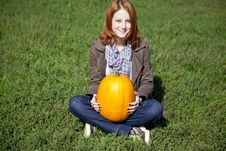 Free Woman Sitting At Green Grass And Keeping Pumpkin. Stock Photography - 16562502
