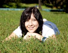 Free Girl With Blue Eyes On Green Grass In The Park. Royalty Free Stock Images - 16564319