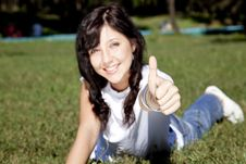 Free Girl With Blue Eyes On Green Grass In The Park. Royalty Free Stock Image - 16564336
