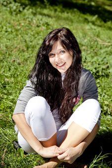 Free Brunette Girl On Green Grass Stock Photography - 16564652