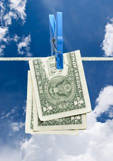 American Dollar On Rope Royalty Free Stock Image