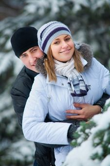 Beautiful Couple In Winter Park. Royalty Free Stock Image