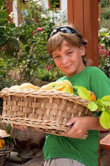 Free Boy With Fruit Basket . Royalty Free Stock Photos - 16567368