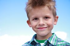 Free Cute Young Boy Smiling At The Viewer Royalty Free Stock Photos - 16569248