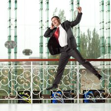 Smiling Jumping Man With Mobile Phone Royalty Free Stock Photography