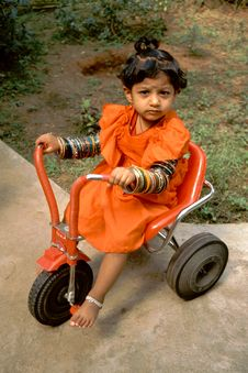 Free Baby, Bangles And Tricycle Stock Photo - 16574550