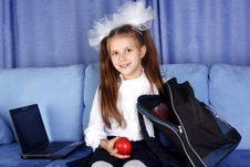Schoolgirl With Laptop, Backpack And Red Apple Royalty Free Stock Image