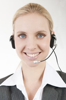 Free Businesswoman Talking On Headphones Stock Photography - 16577552