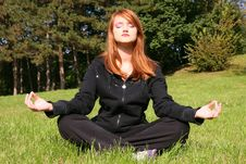 Girl Meditating In Nature Stock Photo